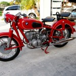 BMW R60/2 - 1966 - Left Side View, Motor and Transmission, Granada Red Paint, Front Forks and Wheels.