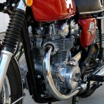 Honda CB450 - 1974 - Engine and Gearbox, Footrest, Reflector, Side Stand, Points Cover and Spark Plug.