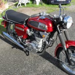 BSA Rocket 111 - 1969 - Right Side View, Reflector, Exhaust Headers, Front Forks and BSA Badge.