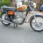 BSA Rocket 3 - 1971 - Right Side View, Kick Start, Tank, Side Panel, Engine Case, Front Mudguard, Carbs and Stand.