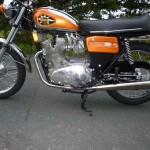 BSA Rocket 3 - 1971 - Side View, Engine, Muffler, Gas Tank, Badge and Side Panel.