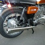 BSA Rocket 3 - 1971 - Swinging Arm, Silencer, Shock Absorber and Rear Hub.