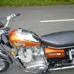 BSA Rocket 3 - 1971 - Chrome Gas Tank, Seat, Cylinder Head and Filler Cap.