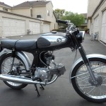Honda Super 90 - 1965 - Muffler, Saddle, Front Wheel and Forks.