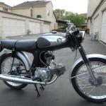 Honda Super 90 - 1965 - Muffler, Saddle, Front Wheel and Forks.