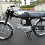 Honda Super 90 - 1965 - Air Filter, Gas Tank, Frame and Wheels.