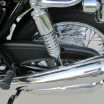 Kawasaki KZ900 - 1976 - Mufflers, Chain Guard, Shock Absorber and Footrest.