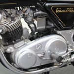 Norton Commando 750 - 1972 - Primary Chain Case, Footrest and Exhaust Downpipe.