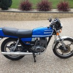 Suzuki GT250X7 - 1979 - Right Side View, Tank, Side Panel, Kick Start, Wheels and Engine.