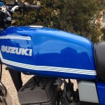 Suzuki GT250X7 - 1979 - Cylinder Head, Fuel Tank and Suzuki Decal.