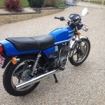 Suzuki GT250X7 - 1979 - Exhaust Pipe, Tail Piece, Rear Shock Absorber and Flasher.