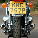 Suzuki GT750 - 1975 - Rear Wheel, Mufflers, Exhaust, Shocks, Mudguard, Chain and Number Plate.