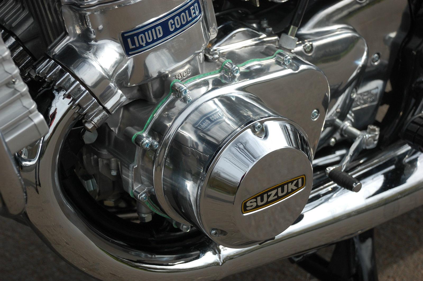 Suzuki GT750 - 1975 - Barrels, Generator Cover, Exhaust and Sprocket Cover.