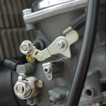 Suzuki GT750 - 1975 - Carburettor and Choke Lever.