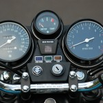 Suzuki GT750 - 1975 - Clocks, Speedo, Tacho, Water Temp, Ignition Switch and Handlebar Clamp.