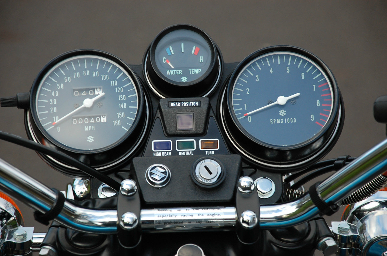 Suzuki GT750 - 1975 - Clocks, Speedo, Tacho, Water Temp, Ignition Switch and Handlebar Clamp.