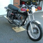 Triumph Trident T140V - 1973 - Front Stainless Wheel Rim, Front Fender, Headlight and Forks.