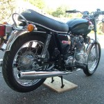 Triumph Trident T140V - 1973 - Muffler, Exhaust, and Rear Wheel.