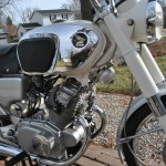 Honda CB160 Sport - 1969 - Exhaust Downpipes, Starter Motor, Transmission and Honda Tank Badge.
