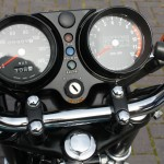 Kawasaki S3 400 - 1974 - Clocks, Speedo, Tacho, Ignition Switch and Handlebar Clamps.