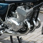Kawasaki S3 400 - 1974 - Oil Pump Cover, Exhausts, Centre Stand, Oil Pump Cable and Engine Case.