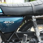 Kawasaki S3 400 - 1974 - Side Panel, 400 Badge, Seat, Rear Shock, Grab Bar and Chain Guard.