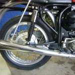 Norton Atlas - 1966 - Rear Suspension, Borrani Wheel Rim and Silencer.