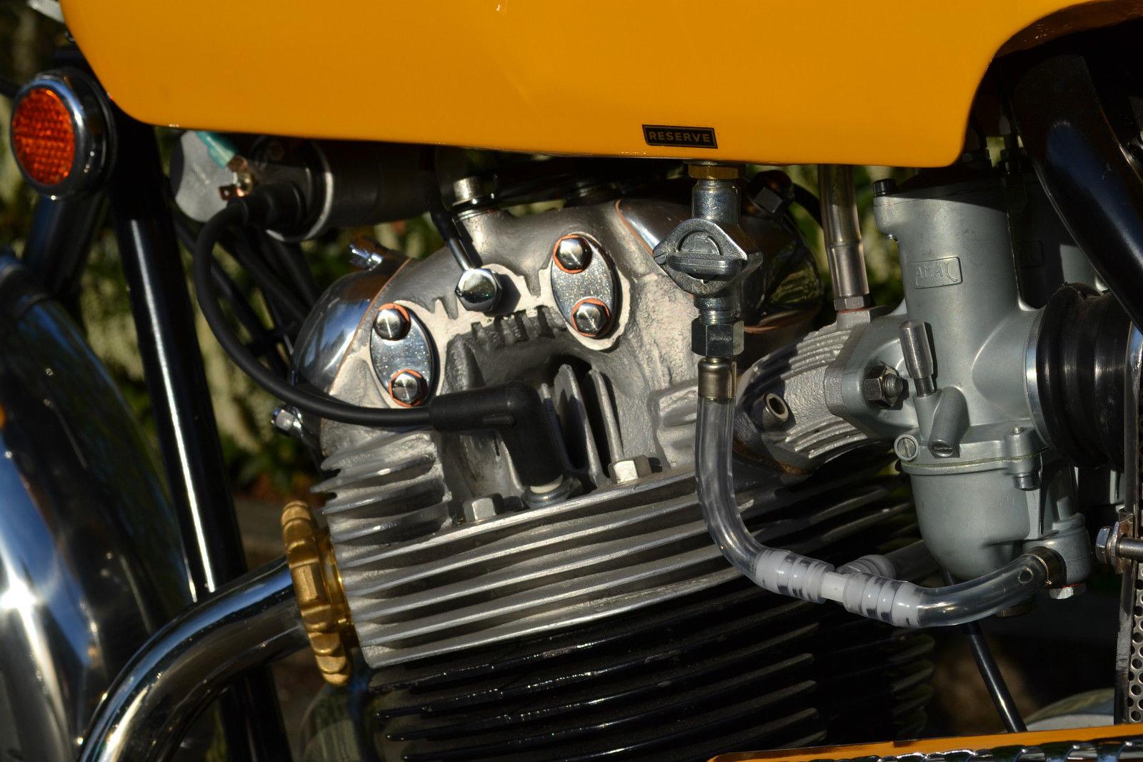 Norton Commando S-Type - 1969 - Cylinder Head, Fuel Tap, Fuel Line and Spark Plug.
