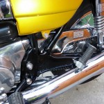 Suzuki GT380 - 1974 - Chain Case, Muffler, Side Panel and Footrest.