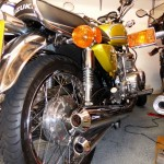 Suzuki GT380 - 1974 - Rear Wheel, Exhaust Baffles, Rear Wheel, Rear Wheel and Fender.