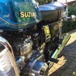 Suzuki GT750B - 1977 - Suzuki Badge, Side Panel, Water Cooled and Seat.