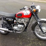Triumph Daytona - 1973 - Front Forks, Daytona Decal, Triumph Badge, Muffler and Header.