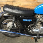 Triumph Tiger - 1973 - Side Panel, Muffler, Seat, Rear Shock and Kick Start.