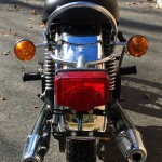 Triumph Tiger - 1973 - Rear Light, Fender, Mudguard, Mufflers and Light Lens.