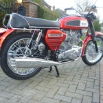 BSA Rocket 3 - 1969 - Rear Wheel, Rear Mudguard, Fender, Shock Absorber and Pipes.
