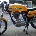 Ducati Desmo 250 - 1974 - Left Side View, Petrol Tank, Side Panel and Engine.