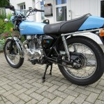 Honda CB360 - 1979 - Right Side View. Tail Piece, Seat, Shock Absorber, Chain and Sprockets, Side Panel and Wheel.