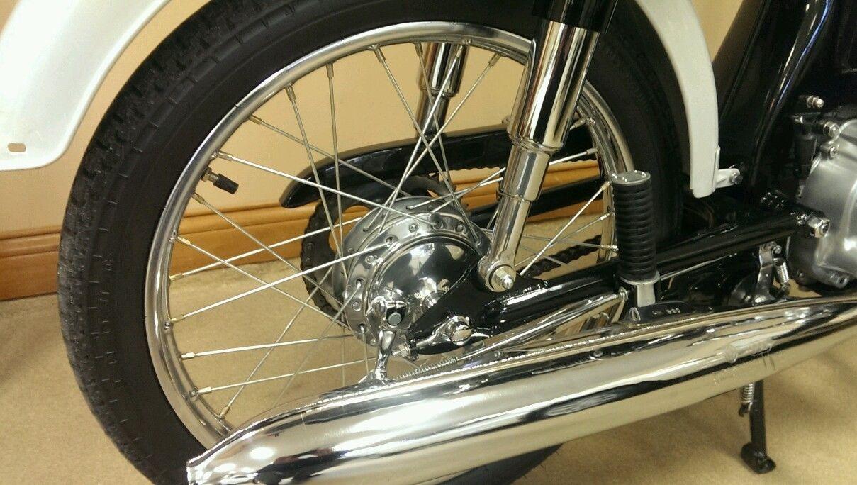 Honda S90 -1966 - Exhaust, Silencer, Muffler, Rear Brake Hub, Spokes and Wheel Rim.