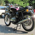 Triumph Trident T160 - 1975 - Muffler, Rear Wheel, Sprocket, Main Stand, Chain and Sprocket.
