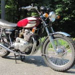 Triumph Trident T160 - 1975 - Front Fender, Front Wheel, Forks, Clocks and Headlight.