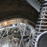 Triumph X-75 Hurricane - 1973 - Rear Wheel Rim, New Spokes and Shock Absorber.