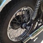 BSA A65 Lightning - 1969 - Rear Wheel, Stainless Spokes, Muffler, Swing Arm and Shock Absorber.