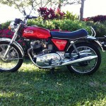 Norton Commando 850 - 1974 - Left Side View, Gas Tank, Forks, Saddle, Mufflers and Shocks.