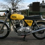 Norton Commando -1975 - Tank, Exhausts, Silencer, Primary Chain Cover, Wheels and Tyres.
