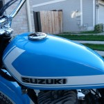 Suzuki TS250 - 1972 - Gas Tank, Suzuki Badge and Gas Cap.