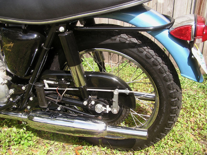 Triumph Trophy TR6 - 1968 - Chain Guard, Rear Brake Arm, Shock Absorber and Muffler.