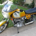 BMW R90S - 1975 - Left Side View, Fairing, Screen, Side Stand, BMW Badge, Mirror, Fender and Wheels.