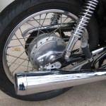 Honda 400 Four - 1976 - Silencer, Muffler, Rear Brake Drum, Shock Absorber and Footrest.