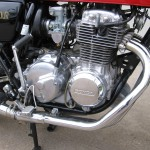 Honda 400 Four - 1976 - Engine and Gearbox, Kick Start, Clutch Cover, Carburettors, Cylinder Head and Spark Plugs.