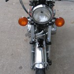 Honda 400 Four - 1976 - Headlight, Indicators, Front Mudguard, Front Forks and Wheel.